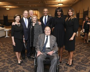 This Saturday, April 21, 2018, photo provided by the Office of former U.S. President George H.W. Bush, shows Bush, front center, and past presidents and first ladies Laura Bush, from left, George W. Bush, Bill Clinton, Hillary Clinton, Barack Obama, Michelle Obama and current first lady Melania Trump in a group photo at the funeral service for former first lady Barbara Bush, in Houston.